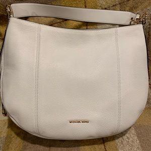 Michael Kors white leather satchel bag.